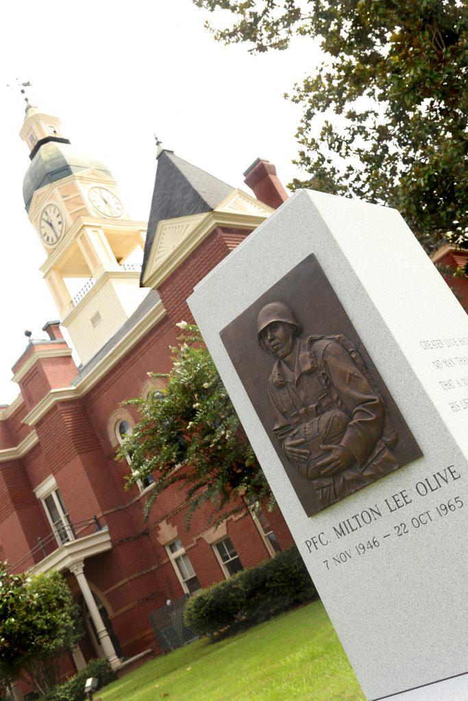 Lexington building and monument for PFC Milton Lee Olive